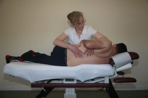 Surrey Chiropractor Working With Patients Back