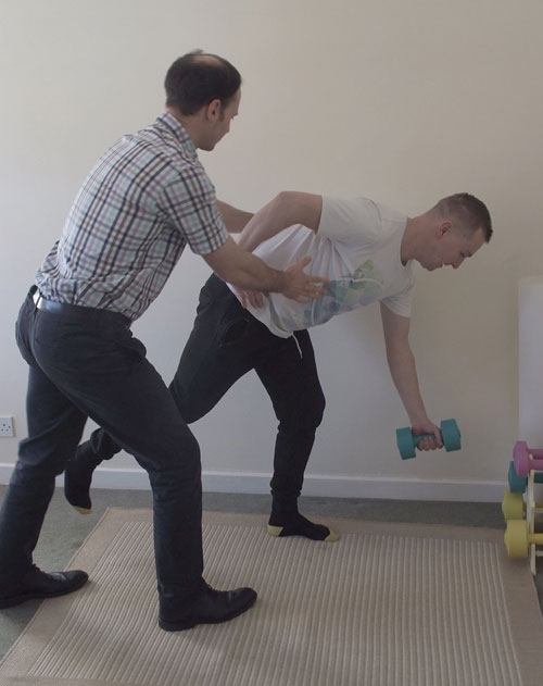 Chiropractic Care & Rehabilitation With Dumbbell